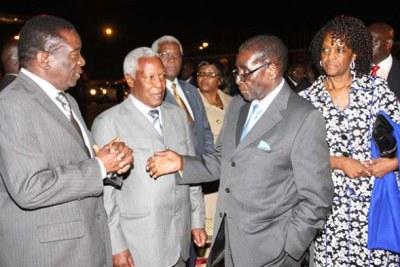 From left, Vice President Emmerson Mnangagwa, Defence Minister Sydney Sekeramai, President Robert Mugabe, and First Lady Grace Mugabe.