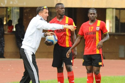 Tactical Nous. Coach Micho (L) passing on tips to defender Murushid Juuko (C) and forward Farouk Miya during a recent Cranes game at Mandela National Stadium Namboole.