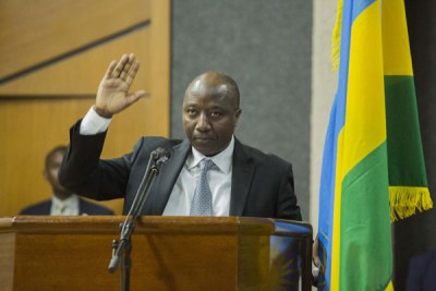 Edouard Ngirente taking his oath of office in Parliament as Rwanda's Prime Minister.