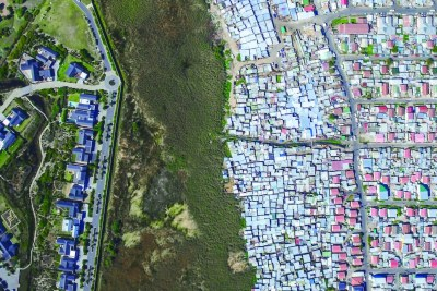 An aerial view of a gated community in Cape Town South Africa, left  directly adjacent to Masiphumelele