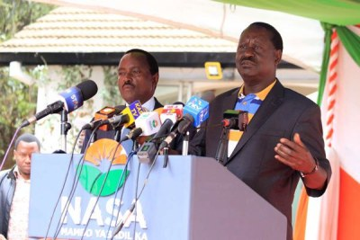 Nasa leaders Raila Odinga (right) and Kalonzo Musyoka address the media at Okoa Kenya offices in Nairobi on September 8, 2017.