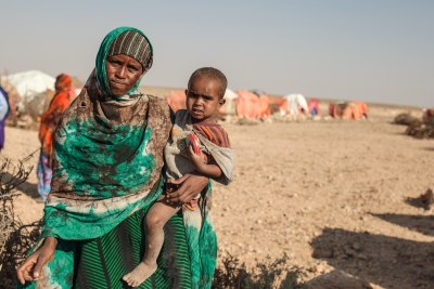 A refugee and her son, who were forced by drought to enter a camp for displaced people.