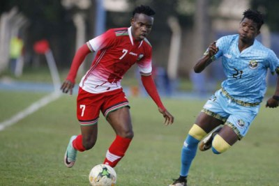 Harambee Stars winger Ovella Ochieng (left) dribbles past Zanzibar's Yabdul-Aziz Makame during their Cecafa Senior Challenge Cup Group A match on December 9, 2017 at Kenyatta Stadium, in Machakos.
