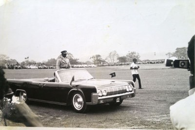 Idi Amin arrives at Kololo Independence grounds in an open American Chevrolet to be sworn in as president.