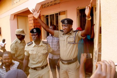 Former Buyende DPC Muhammad Kirumira surrenders to FSU officers during his arrest at his home on February 1, 2018.