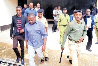 Joseph Mbilinyi leaves the mbeya resident Magistrate's Court after being sentenced to five months in jail.(file photo).