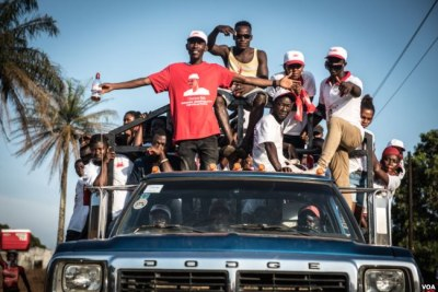 Supporters of the ruling All Congress Party ride a truck during a rally in Port Loko, Sierra Leone