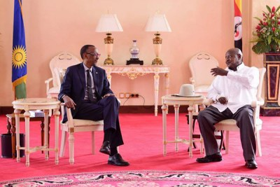 Rwandan president Paul Kagame, left, and his Ugandan counterpart Yoweri Museveni meet at State House Entebbe on March 25, 2018.(file photo).