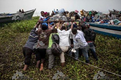 Over 50,000 people have fled by boat across Lake Albert to Uganda since mid-December.