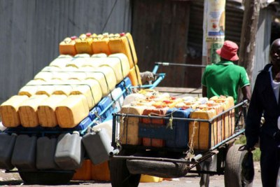 A water vendor pulls a hand cart with jerricans containing water at Kaloleni estate in Nairobi.