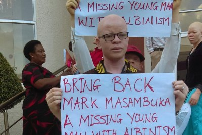 Malawians protest against abduction and murder of a 22-year-old person with albinism, Mcdonald Masambuka of Machinga.
