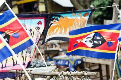 Swaziland flag among curios for sale.