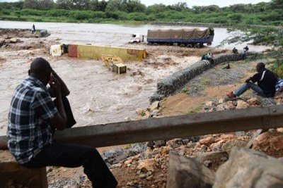 Vehicles submerged in River Malmalte on the Kapenguria-Kainuk-Lodwar Road following heavy rains which left motorists stranded on either side of the road connecting West Pokot and Turkana counties.