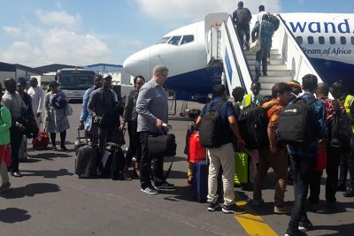Passengers board RwandAir.