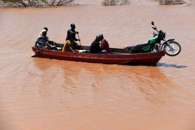 Residents of Bandi village, Tana River County, leave their homes after they were evicted by floods on May 18, 2018.