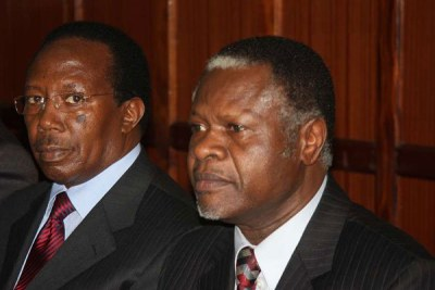 Former Kenya Power and Lighting managing director Samuel Gichuru (left) and former Finance minister Chris Okemo follow proceedings of their extradition case at the High Court on July 11, 2011.