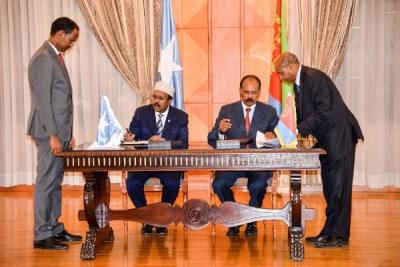 President of Eritrea President Isaias Afwerki and Somalia's President Mohammed Abdullahi Mohammed.