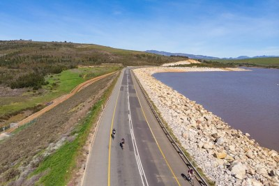 Cyclists ride past Theewaterskloof Dam, which has seen improved water levels after a prolonged drought.