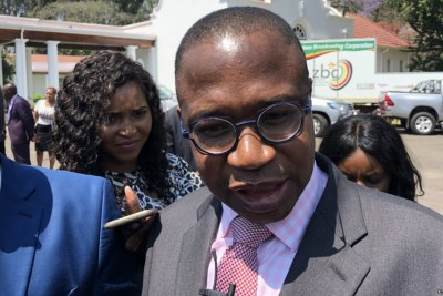 Mthuli Ncube, Zimbabwe's new finance minister, talking to reporters after taking oath of office in Harare (file photo).