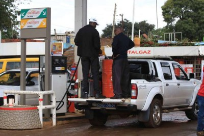 A customer fills a storage tank with diesel at a petrol station in Nyeri on September 6, 2018.