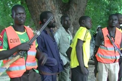 A self-defence group guards a school in Cameroon. (file photo)