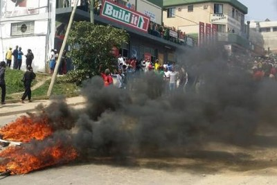 Protesters burn tyres in the commercial city of Manzini during pre-election demonstrations against poor pay and working conditions.