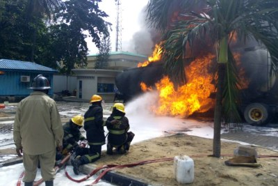 Fire fighters putting out fire from an articulated vehicle (file photo).