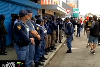 Police outside the Jesus Dominion International Church in Sidwell, Port Elizabeth.