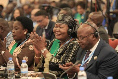 MPs follow proceedings during a session of the Fifth Pan-African Parliament at Kigali Convention Centre.