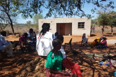 Patients and MSF team meet at an outreach in Mpani village.