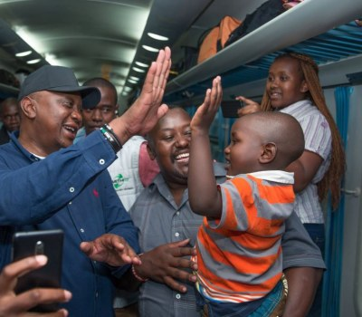 Hugs, Smiles and Selfies as Kenyatta Surprises Train Passengers