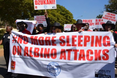 Petitioners march to Malawi parliament to protest attacks on people with albinism.