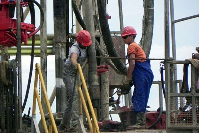 Tullow Oil workers at a rig in Buliisa in Uganda