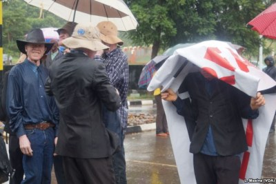 Protesters braved the rain in their bid to seek a solution aiming to end attacks on people with albinism in Malawi (file photo).
