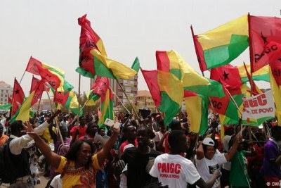 Supporters of the PAIGC party in Guinea-Bissau wave red, green and yellow flags as they celebrate the party's victory in the 2019 parliamentary election (file photo).