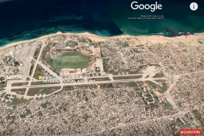 An aerial view of Tripoli showing Mitiga International Airport.