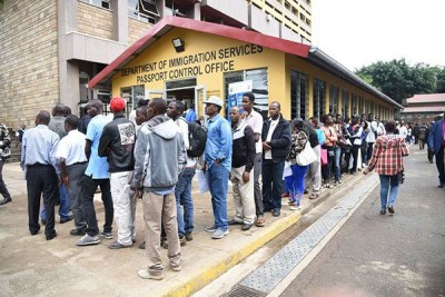 Kenyans queue to apply for passports at Department of Immigration at Nyayo House, Nairobi, on May 21, 2018.