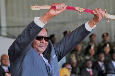 President Peter Mutharika displays the Sword of Command after being presented to him by Malawi Defence Force Commander General Griffin Spoon Phiri.