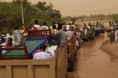 Evacuation of people affected by floods in El Jeili in Khartoum North, August 22, 2019.