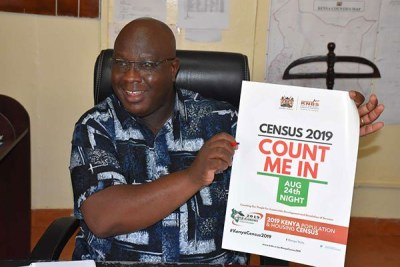 Isiolo County Commissioner Joseph Kanyiri displaying a census 2019 poster at his office in Isiolo Town on August 15, 2019.