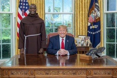 2019 Global Teacher Prize winner, Kenya's Peter Tabichi meets U.S. President Donald Trump on September 16, 2019.