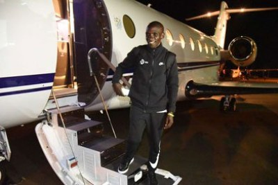 "World marathon record holder Eliud Kipchoge boards a private jet at Eldoret International Airport on October 7, 2019 on his way to Vienna, Austria for the ""INEOS 1:59 Challenge""."