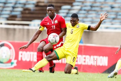 Harambee Stars captain Victor Wanyama (left) vies for the ball with Mozambique's Manuel Kambala during their friendly match on October 13, 2019 at Moi International Sports Centre ,Kasarani in Nairobi.