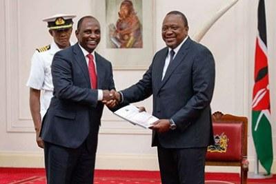 Labour Cabinet Secretary Ukur Yattani (left) hands President Uhuru Kenyatta the 2019 Kenya Population and Housing Census results at State House, Nairobi, on November 4, 2019