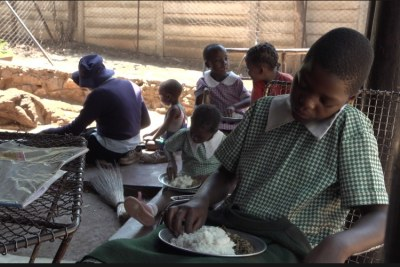 Orphans in Harare's Kambuzuma township eat a meal provided by the charity Faith Community Support.