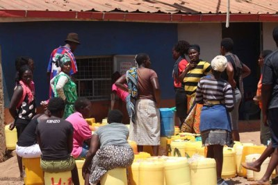 Residents wait to buy water from a local vendor (file photo).