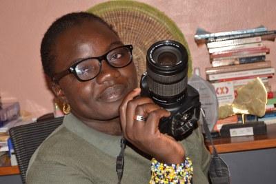 Fatou and her camera.JPG