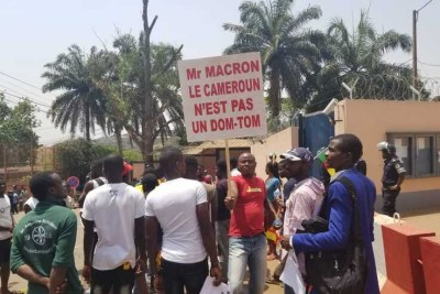 Youths protest against French President Emmanuel Macron's declarations over how Cameroon is handling the conflict in its English-speaking regions outside the French embassy in Yaounde, Feb. 24, 2020.