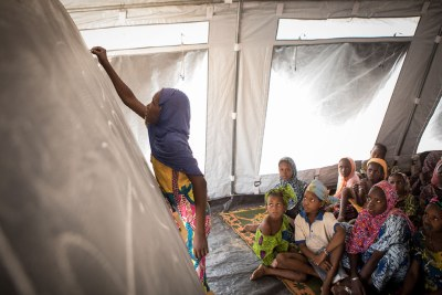 A student writes on the blackboard of a temporary learning space in a camp for internally displaced people in Mopti, Mali, in April 2019.