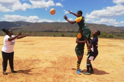 Sahumani Secondary rugby team coach Patricia Mukunike-Chakanya is throwing the ball at Cathrine Muranganwa lifted by Trish Kandemiri and Velme Nyarumwe during a line-out at Sahumani Secondary, Honde Valley, September 11 2020.